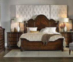 A photograph of a traditional bedroom, headboard, footboard, dresser and two night stands.