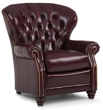 A burgundy button back leather chair with nailhead trim by Smith Brothers furniture