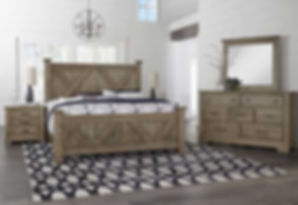 A photo of a rustic Vaughan-Bassett bedroom suite, dresser, mirror, bed and nightstand