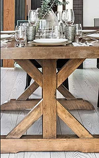 A Canadel furniture dining room table in rustic wood finish