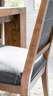 A Canadel furniture side chair in rustic wood finish with gray plaid fabric seat