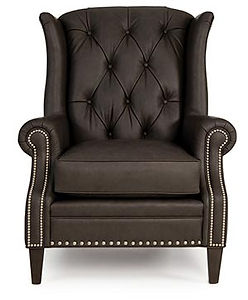 A dark brown leather button back chair with nailhead trim by Smith Brothers furniture