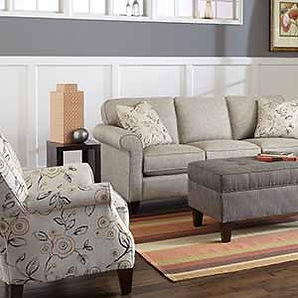 A living room setting with Craftmaster furniture sofa, chair and ottoman in print fabric.
