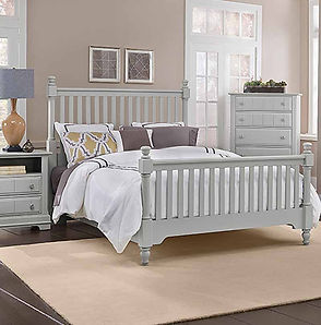 A gray Vaughan-Bassett bedroom suite with headboard, footboard, rails, nightstand and chest of drawers.