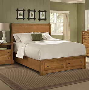 A bedroom scene with a Vaughan-Bassett headboard, footboard, rails, nightstand and chest of drawers.