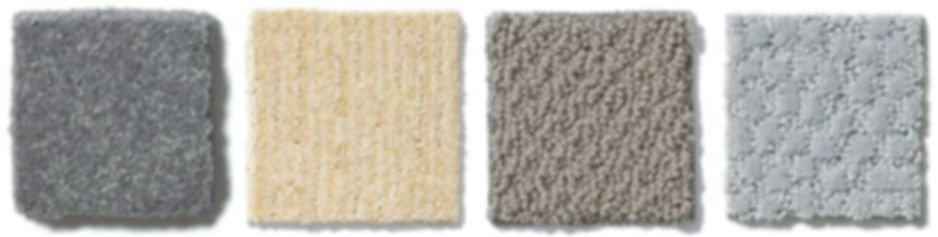 A row of different colored and textured carpet swatches by Shaw Floors