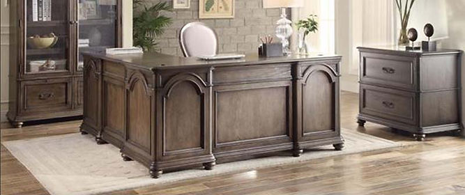 A dark finish L-shaped Riverside furniture desk, desk chair, console, and glass door cabinet