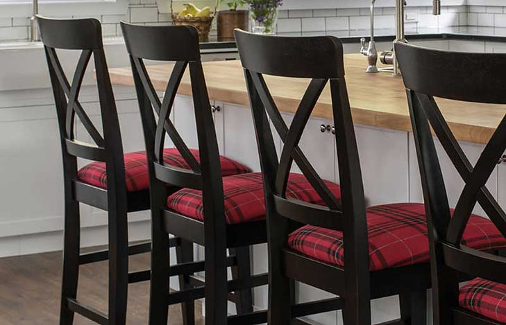 A kitchen featuring black barstools with red plaid seats by Canadel furniture