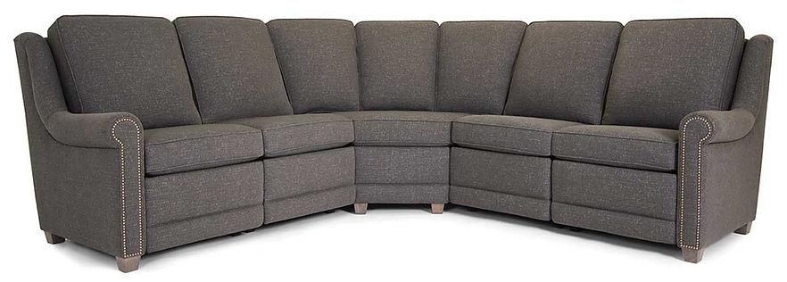 A neutral tone fabric sectional sofa with nailhead trim by Smith Brothers furniture
