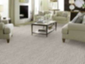 A photo of a living room with textured gray carpet by Shaw Floors