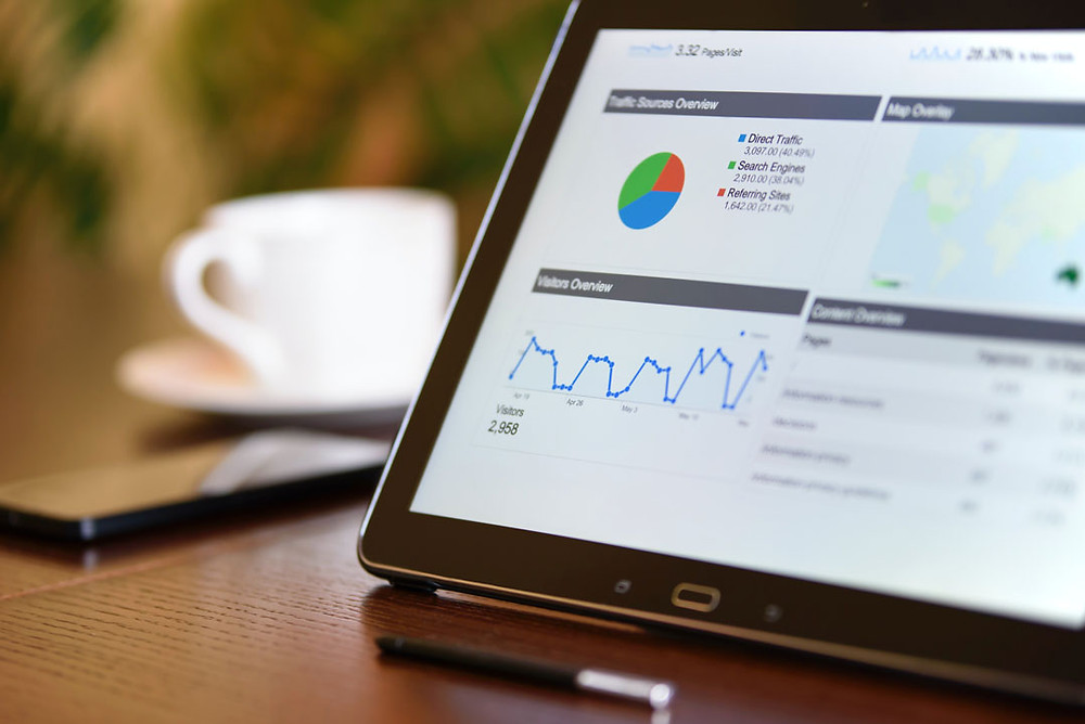 Tablet displaying website analytics data for use in marketing tactics.