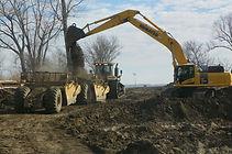 Excavator Dumping Dirt_Pruss Excavation.