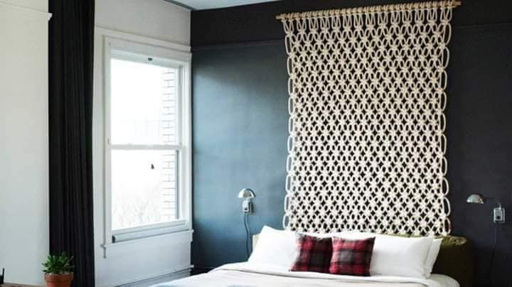 Knitted panel on the wall to cover stains.