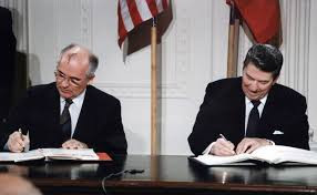 U.S. President Ronald Reagan and Soviet General Secretary Mikhail Gorbachev signing the INF Treaty in the East Room at the White House in 1987. The Intermediate-Range Nuclear Forces Treaty (INF) is a 1987 agreement between the United States and the Soviet Union. The treaty eliminated nuclear and conventional ground-launched ballistic and cruise missiles with intermediate ranges. (Photo by: Universal History Archive/UIG via Getty Images)