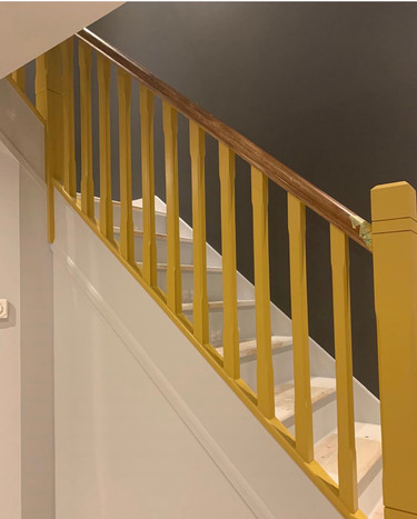 Colour blocking with pop of yellow on staircase