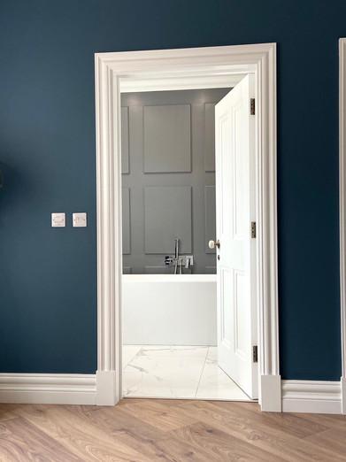 Elegant bathroom with panelled details