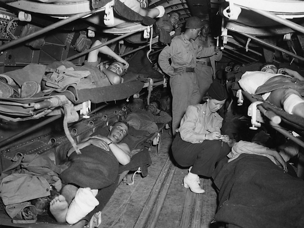 Army nurses attending WW II wounded going home
