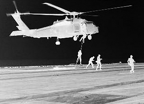 US Navy Seals disembarking at night.
