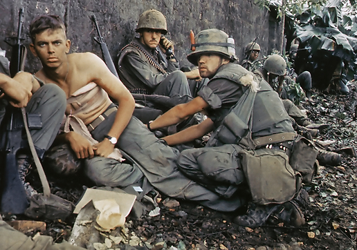Viet Nam field medic with all his packs in action. Note frozen eye stare of PTSD