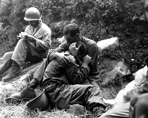 "Korean medic comforting a soldier with ""shell shock'' (PTSD)"