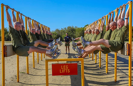 Marine doing leg lifts at Boot camp with their DI.