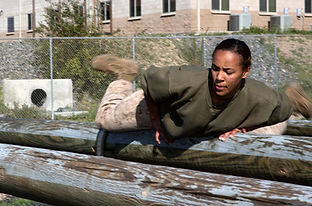 Women Marine in combat training