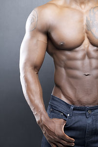 Black fitness model in jeans with no shi