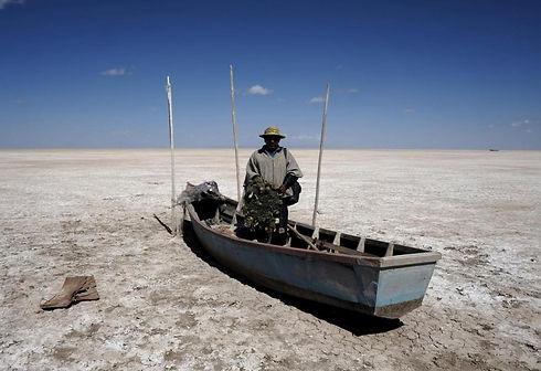 Bolivian man in boat on the Salar de Uyuni