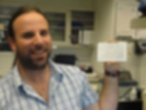 Tomer Holding his first T-cell ELISPOT plate