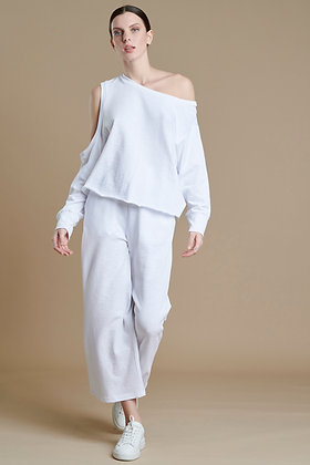 House of Angels white asymmetric top with open shoulder sleeve