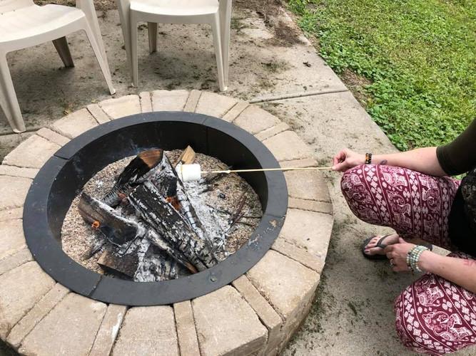Student around fire pit