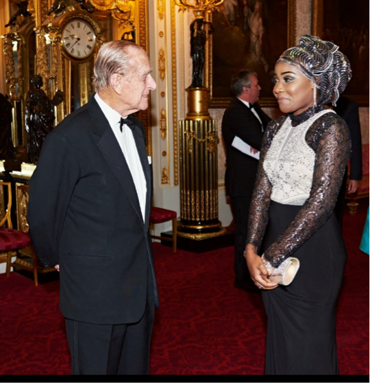 Rukky Yussef meeting the Duke of Edinburgh after giving a speech at Buckingham Palace