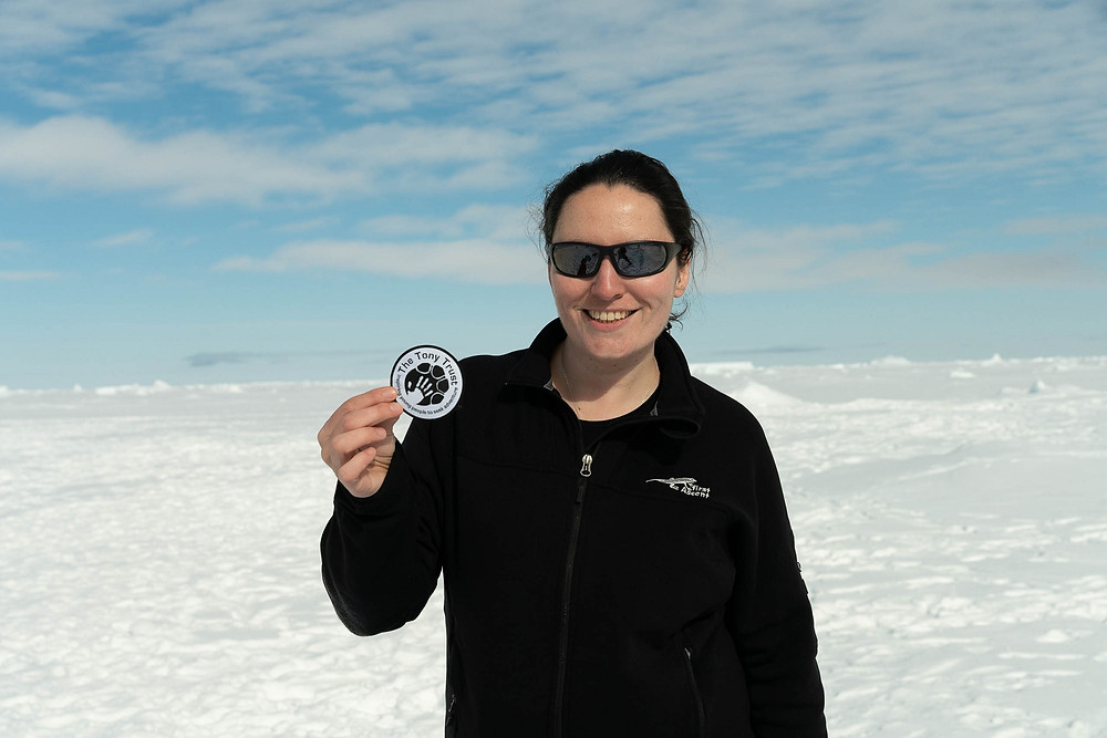 Claire with the Tony Trust Patch in Antarctica