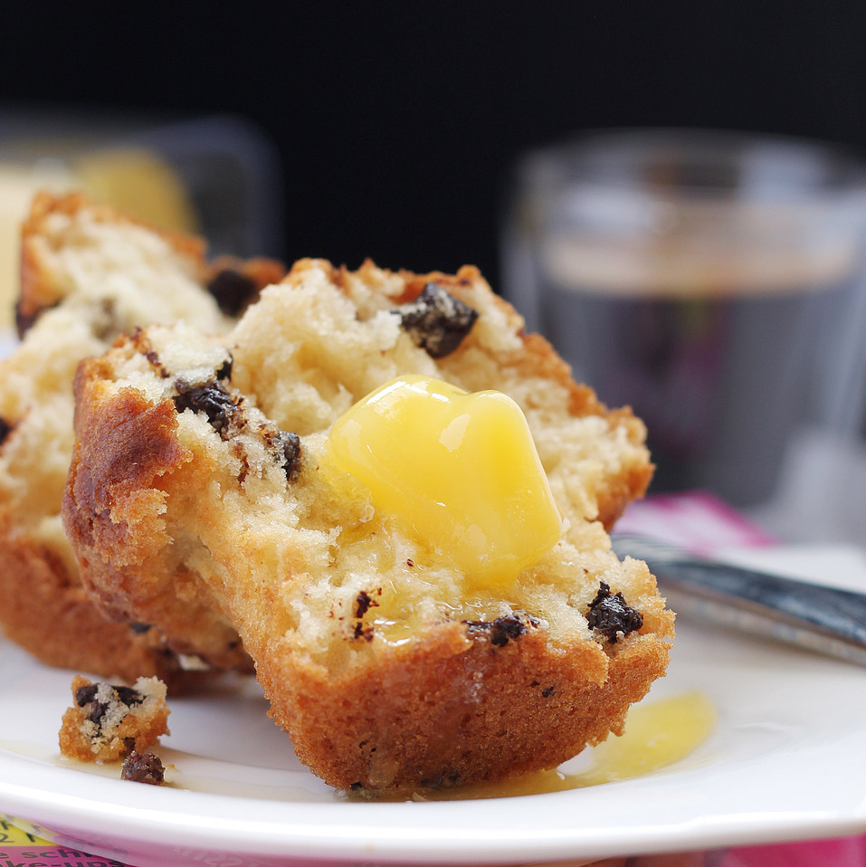 butter-melting-on-warm-muffin-over-coffe