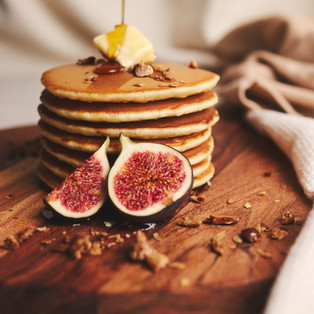 vertical-shot-pancakes-with-syrup-butter