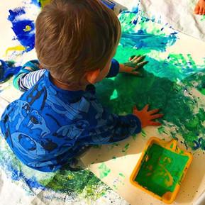 messy hand green paint.JPG