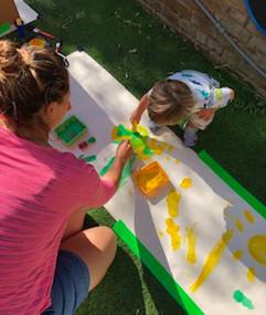 mum daughter paint outside.jpg