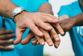 team-volunteers-stacking-hands.jpg