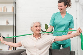 physical-therapist-assisting-old-woman-s