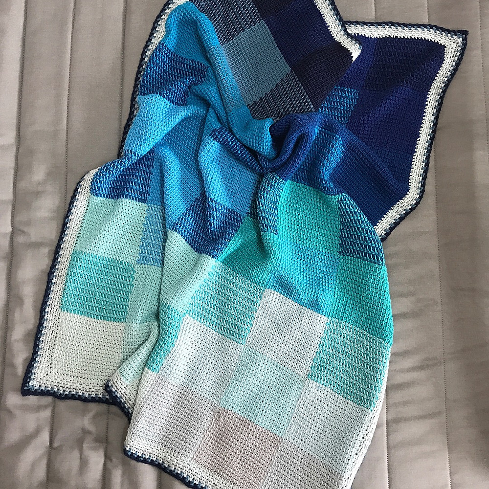 Tunisian Sunset blanket in shades of blue