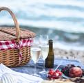 Summer beach  romantic picnic at sunset.