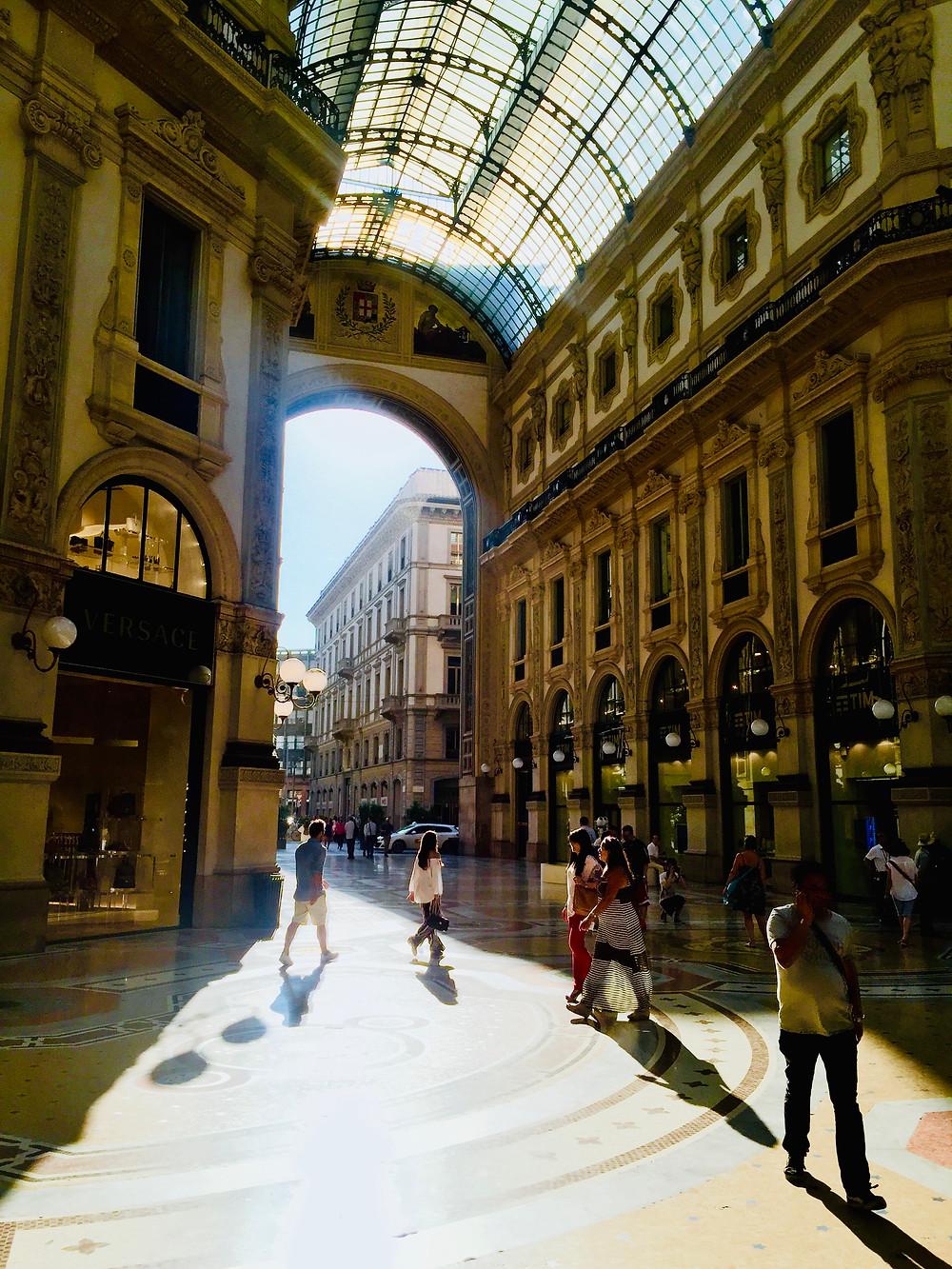 People walking under the glass tiled roof of Galleria Vittorio Emanuele II