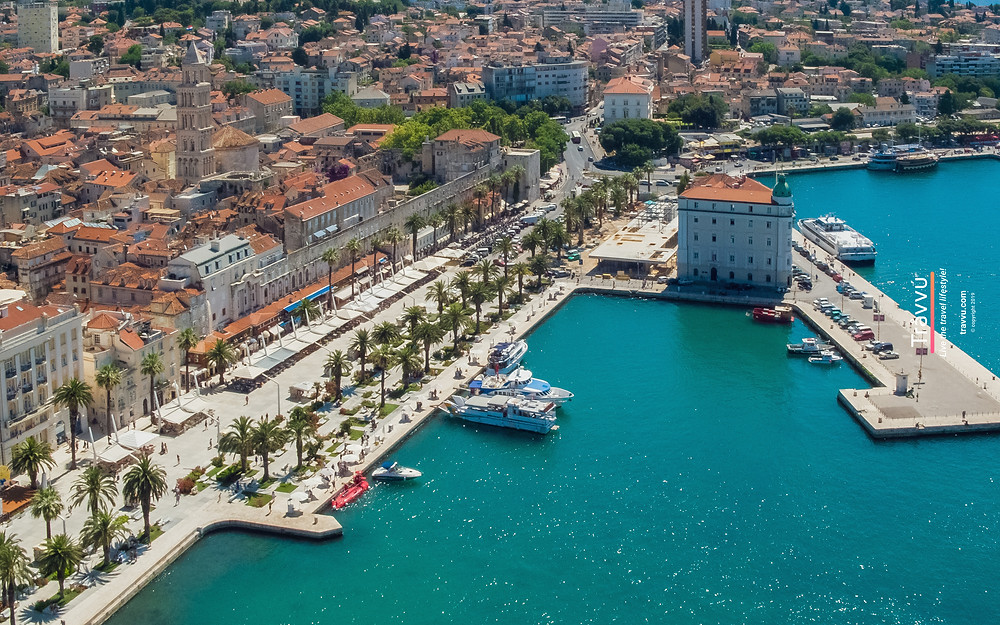 Riva Promenade And Diocletian's Palace In Split, Croatia