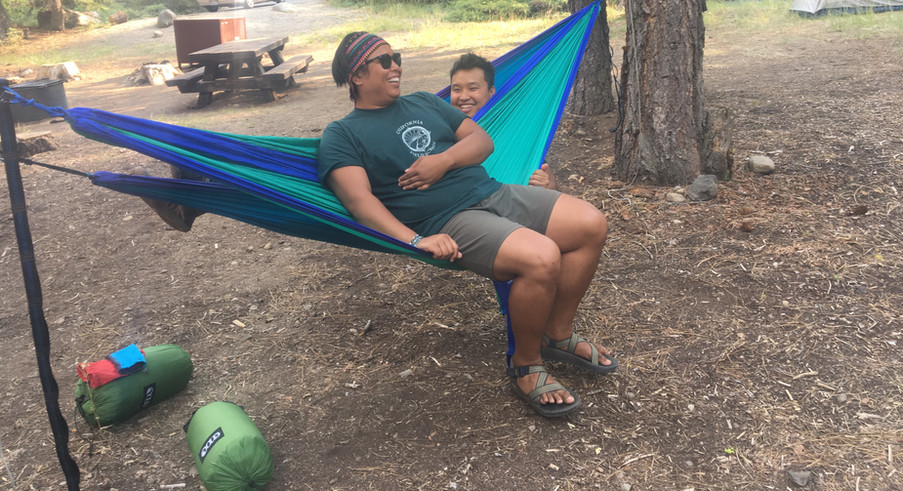 Sean and San hanging around in their hammocks.