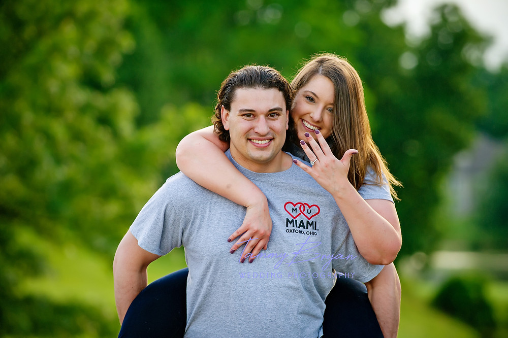 Engagement photography of a bride and groom showing off her engagement ring by Cincinnati and Northern Kentucky best and most affordable wedding photographer Tammy Bryan