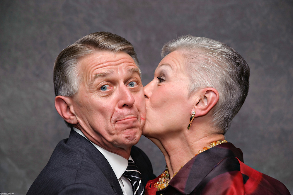 Cincinnati and Northern Kentucky best and most affordable wedding photographer Tammy Bryan's photobooth picture of a lovely woman kissing a handsome man
