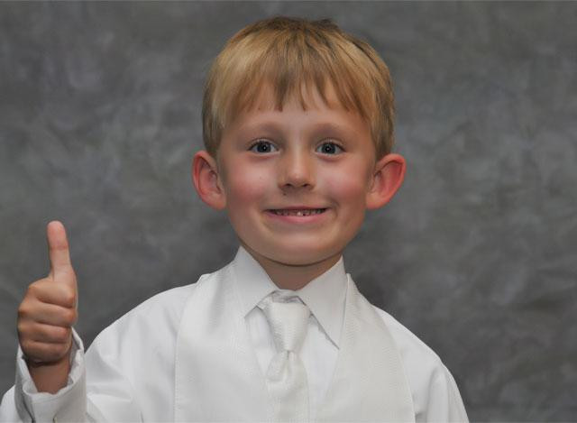 Cincinnati and Northern Kentucky best and most affordable wedding photographer Tammy Bryan's photobooth picture of a young boy in a silk shirt and tie giving the thumbs up sign