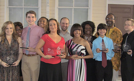 Some of the winners pose with their trophies.