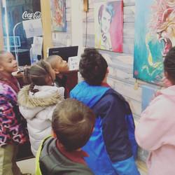 Kids looking at artwork
