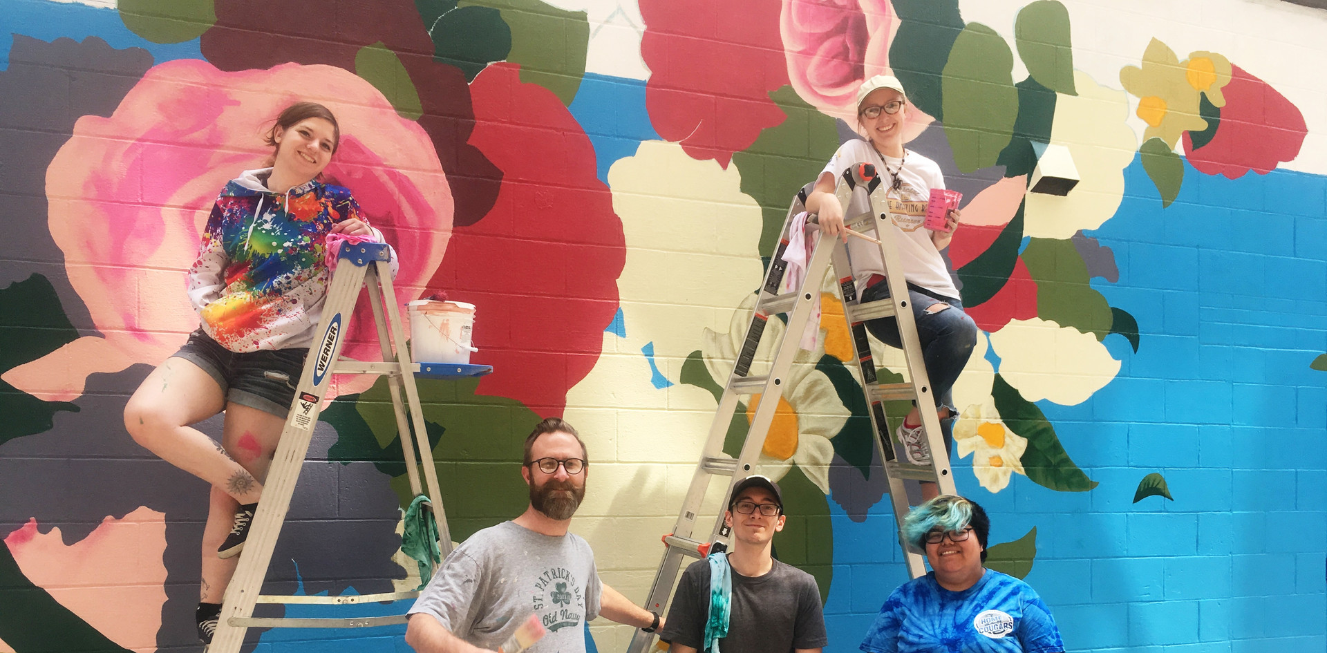SOCA mural team in front of wall.jpg